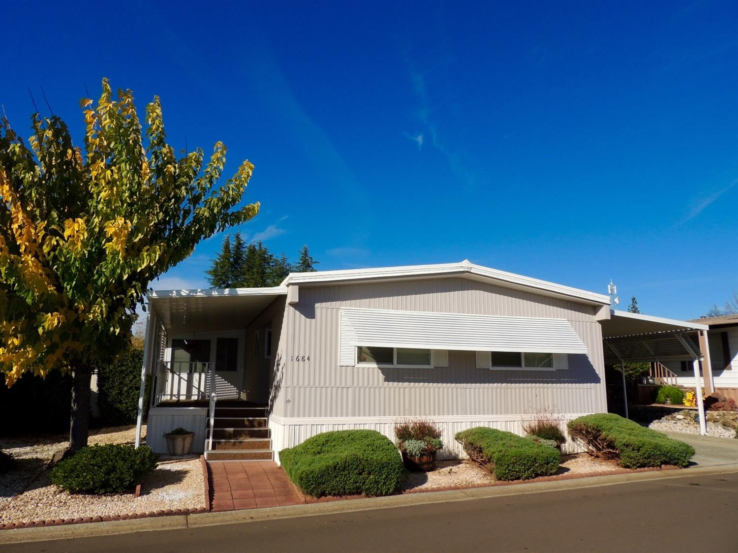 Move in Ready! Light and bright, well maintained 2 bedroom 2 bath home.  Brand New roof 9/2017. Dual pane windows, Central heat and air. Enclosed sunroom, easy maintenance yard. Tandem parking and storage shed. Nice park with many amenities.  Close to shopping and services.