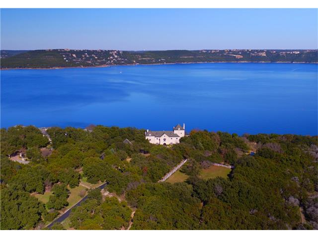 Trophy estate of the Hill Country, almost 7 acres covering one of the highest hills in the area, offering extraordinary panoramic views of Lake Travis' main basin, European influenced manor, formal gardens, and pool and spa that overlook 650' of waterfront. One of the largest private docks with tram access on lake. 2BD/ 2BH vintage guest house with it's own sweeping views of lake. Additional acreage available, see MLS#8389310 with equestrian facilities, sport court, and more.