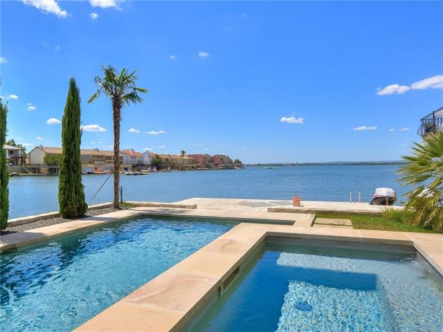 Truly a must see when your heart desires the perfect place on Lake LBJ! A stunning full renovation in 2016 has brought this home to new luxurious standards with the highest quality workmanship in every detail. Relaxing pool overlooking 94' of north facing Lake LBJ open waterfront. 3 deck areas. High-end appliances & detail throughout the 4100 sq. ft. 4 bedroom 5 bath home, featuring additional living space in the media room & second game/living room with fireplace & wet bar. Laundry room on each level.