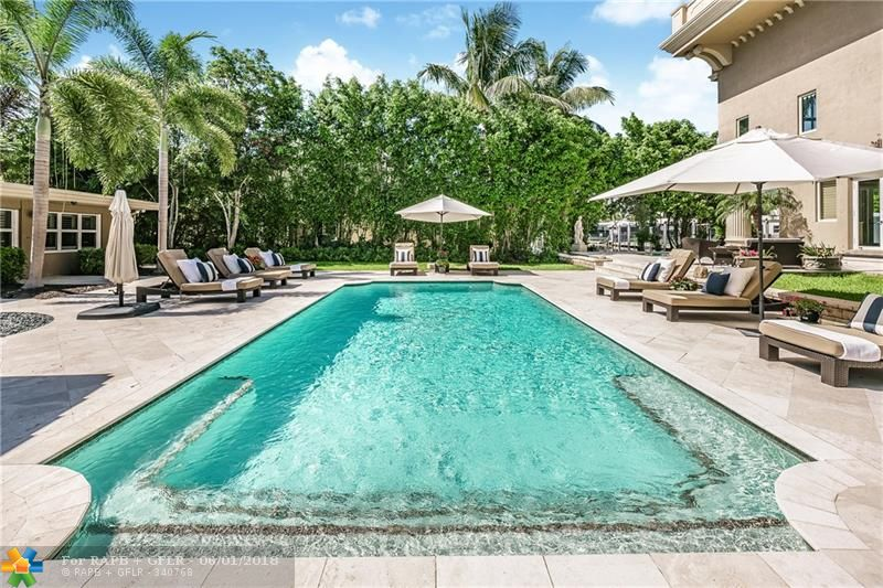 Priced under appraisal!! Exquisite Las Olas Estate with Guest house!!  Magnificent home with soaring windows and amazing water views! Open floor plan, gorgeous limestone floors, and stunning dramatic staircase. Huge bedrooms with private baths, INCREDIBLE theater seats 16, game/billiard room, full gym with sauna/steam rooms, and custom wine cellar! Resort-style heated pool/spa with summer kitchen! Charming 3 bed/3 bath guest house with private entrance! An incredible home for an extraordinary lifestyle!