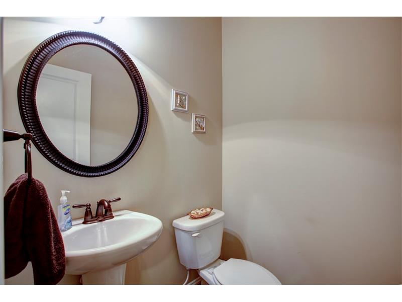 Half bath located off foyer!