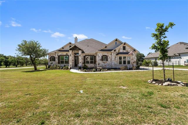 NEW PRICE & MOTIVATED SELLER! Stunning home on ~2 acres, one of the largest lots in the community! Stone exterior leads to a large, open space with high ceilings, tile flooring & tons of natural lighting. Relax in front of the cozy fireplace or entertain in luxurious kitchen w/ breakfast bar, granite counters & SS appliances. Master bath has separate vanities, walk-in shower w/ seating & a garden tub. All bdrs offer generous space & add'l room is perfect for office/game room.