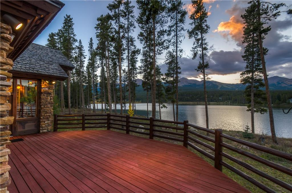 Jon Gunson custom home w/incredible views of Goose Pasture Tarn & the ski area from each room. This magnificent estate features modern but rustic elements including barn wood paneling, an inviting kitchen, & rough-hewn logs and stone. Plenty of room to add a guest house too. Private lake w/fishing, boating & more. Spruce Valley Ranch amenities include trap & skeet, boat house, horse stables, hiking & XC trails in your back yard. Best subdivision in Breck with all your outdoor mountain amenities!