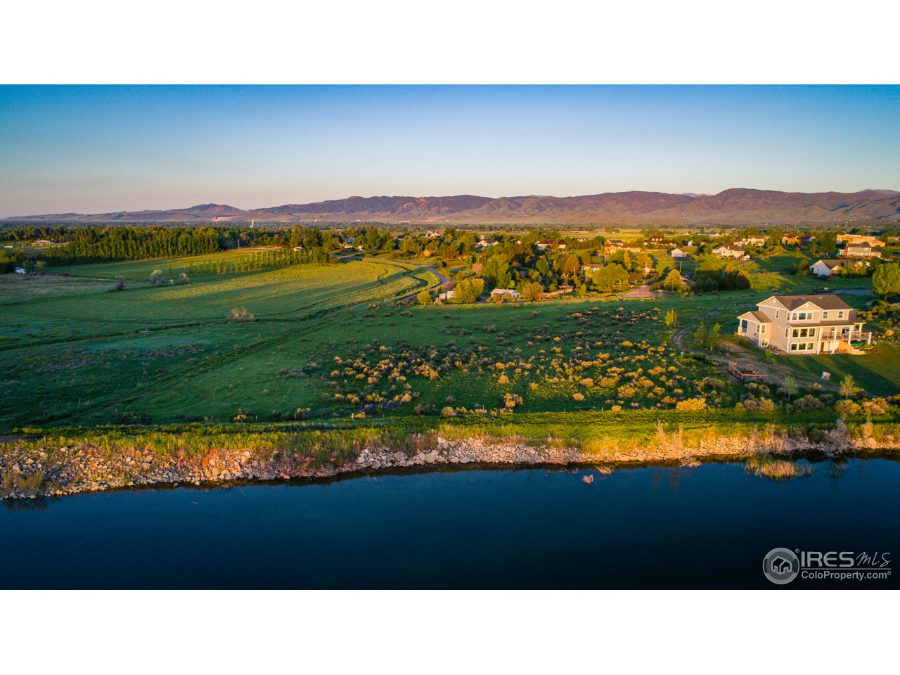 This beautiful 4 acre lot is located at the southern edge of a private Reservoir, giving you a stunning tri view of Terry Lake, the Rocky Mountains and the Reservoir.  Only a 10 minute drive into town.  This south facing plot allows for amazing sunrise and sunset views!! Plenty of open space from all directions.  Water tap included (worth $70,000) in the sale of this property. Potential inclusion of reservoir for recreational use.  A must see!