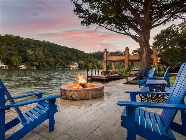 Entertainer's Paradise w 100ft waterfront in the coveted Greenshores neighborhood on Lake Austin.Easy access to Downtown, Domain, & 2222.Home totals 7788SF + 613 SF guesthouse, boat dock & party deck, fire pit, outdoor kitchen.Thoughtfully curated home w/ steel construction, mahogany, custom doors/railings, double arch ceilings, gourmet kitchen & walls of windows throughout.2 master suites, 3 additional bedrooms suites, office, wine cellar, & 4 car garage w/ height for RV.Walking Distance to Ski Shores.