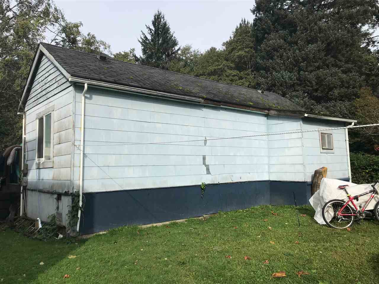 """Build your DREAM HOME with an option for a carriage house as this flat, corner lot has lane access. RS-2 zoning allows potential for a duplex. Tenants pay $1300.00 per month and would like to stay. Dentville is known as a family friendly neighbourhood as well as """"the heart of Squamish""""; all within blocks of schools including Les Aigions which is a French Language School, coffee shop, Back Country Brewing, downtown Squamish and walking trails. This home is priced to sell!"""
