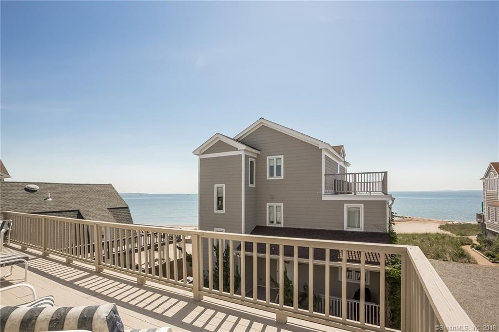 Attention beach lovers! Your beautiful new beach home awaits you. This fabulous 3 bed, 2.5 bath home is a free-standing colonial in a quaint complex, just steps away from a beautifully manicured private beach. Step into the free-flowing first floor with an open concept kitchen, dining room and large living area with a cozy fireplace. Plenty of windows and french doors allow for beautiful views of the water as well as decks on both the front and rear of the first level which make for a perfect balance of indoor and outdoor living! Wake up to the soothing sound of waves breaking onto the sandy shores in the spacious master suite. Relax on the large private master bedroom deck and enjoy a cup of coffee while looking out as the boats go past the Penfield Reef Lighthouse. You can even watch the fireworks from your deck on the 4th of July! Take a nice long walk down Fairfield beach or just enjoy the sun and sand. This house is FEMA compliant and has already been raised. Low condo fees. 3 parking spaces and plenty of guest parking, as well as potential to add additional parking underneath the home. Expansion opportunity in the large attic. Splendor in the sun! A beach lovers retreat!