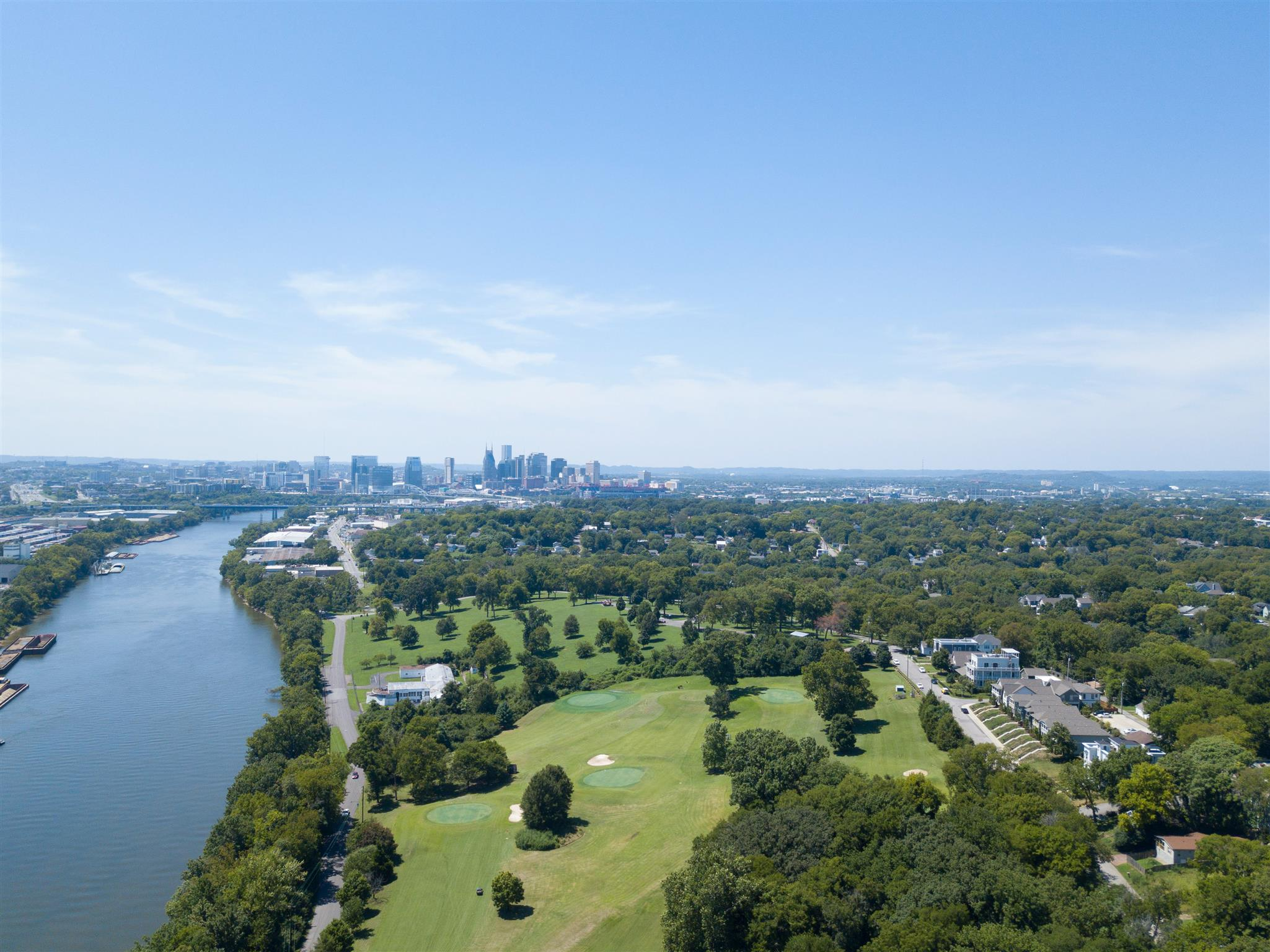 Sweeping view of Downtown Nashville, The Cumberland River, and Shelby Golf course. Hot tub, kitchen and fire pit on rooftop. Wrap around porches, Savant surround sound on all floors, corner lot, fully fenced in yards. 3 car garage. 2200 sq ft of outdoor space! Security and NEST, 4br/4ba, game room, 2 fireplaces, storm Shelter, huge close & storage