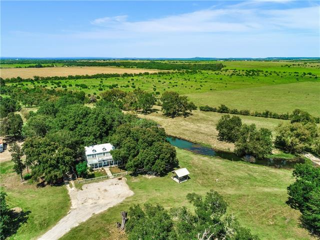 Fabulous Florence ranch with 50 acres, Berry Creek, gorgeous and bountiful mix of pecan, post oak & live oak trees with charming home. The ranch offers the ideal balance of open improved pastures, both sides of Berry Creek and fabulous County Road frontage well suited for development and/or subdivision. Minutes to downtown Florence, Toll Road 130 & Hwy 183 for fast commute  to Georgetown, Austin and Ft. Hood. Numerous outbuildings include barn, workshop & garage. This ranch offers abundant opportunities.