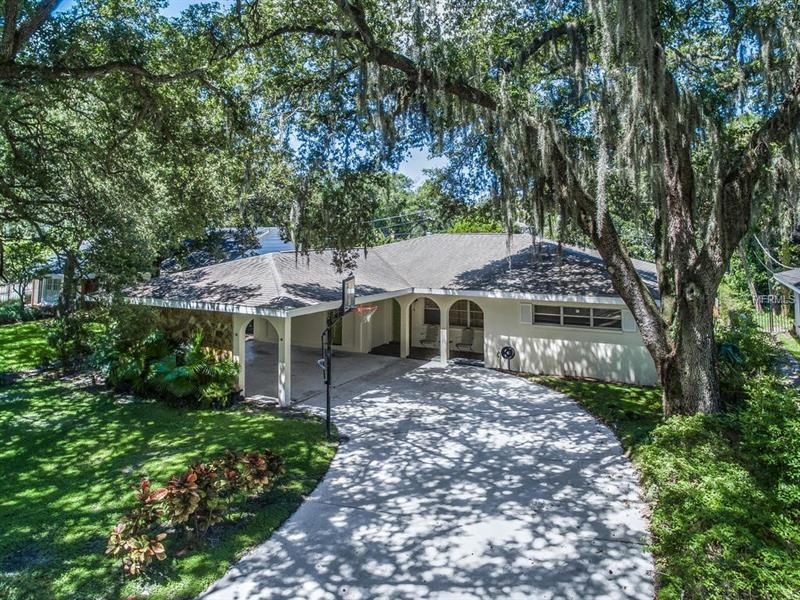 A fantastic opportunity in the heart of coveted Beach Park in South Tampa-zoned for top rated Plant High School District. Location is exceptional-gorgeous million-dollar homes in a quiet neighborhood within walking distance to high-end restaurants, Westshore Plaza, Starbucks, and Panera Bread. Minutes away from the Tampa Airport, I-275, Gandy Bridge, International Mall and the Veterans Expressway. Sellers have taken meticulous care of the home and it shows. Luscious oak trees line this charming 3 bedroom 2 bathroom home on a well-spaced 75 X 127 ft lot. Nestled on a quiet street, this home is freshly painted, has a roof from 2010, AC from 2012, and new water heater. Features a bright open floor plan, high ceilings, spacious rooms, hardwood floors and crown molding. A formal dining room, family room with a stone fireplace, and sunroom leads to the tranquil oasis in your large enclosed backyard with a pergola shaded travertine patio, separate all block storage workshop with electric, and plenty of room for a pool. Features a very large driveway and 2-car carport with two separate entry ways for convenience. This home is a must-see, call today for a private showing.