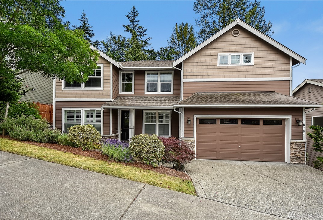 Spacious home located mins to downtown Redmond & walking distance to schools. High end feat incl white painted millwork, open rail staircase, rich hrdwd flrs, custom plantation shutters & cathedral ceiling w/ lrg windows for natural light. Island kitchen w/ slab granite, full height backsplash & stainless appliances. Master w/sitting rm & gas fp, luxurious ba w/ corner soaking tub & custom closets. Main flr den. HUGE basement rec rm w/ wet bar, 4th Bdrm & full Ba. Tons of storage space & more!