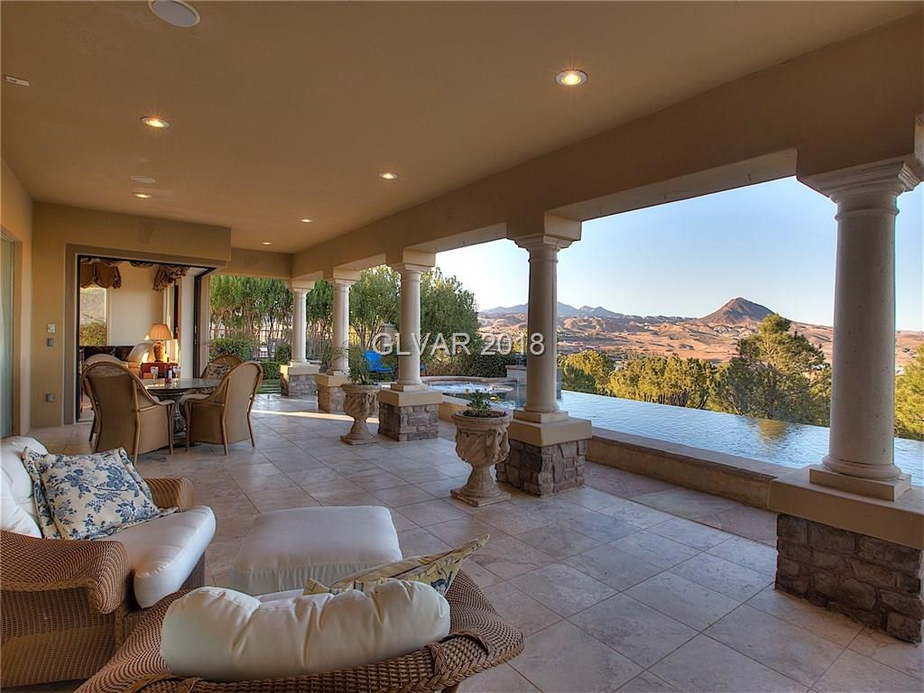 This never before offered Fully Furnished Single Story home in Lake Las Vegas Southshore is one of refined elegance. The panoramic Lake Las Vegas views through the entirely glass wall of the formal living room lets you enjoy the outdoors without ever walking outside. The disappearing corner sliding glass doors in both the family and Master bedroom is a feature unique to Mira Bella. Elegance and true refinement.