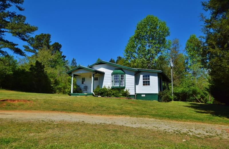 Great home in the country! Ready for your final touches. .84 acre with room for a big garden. This house will not last.