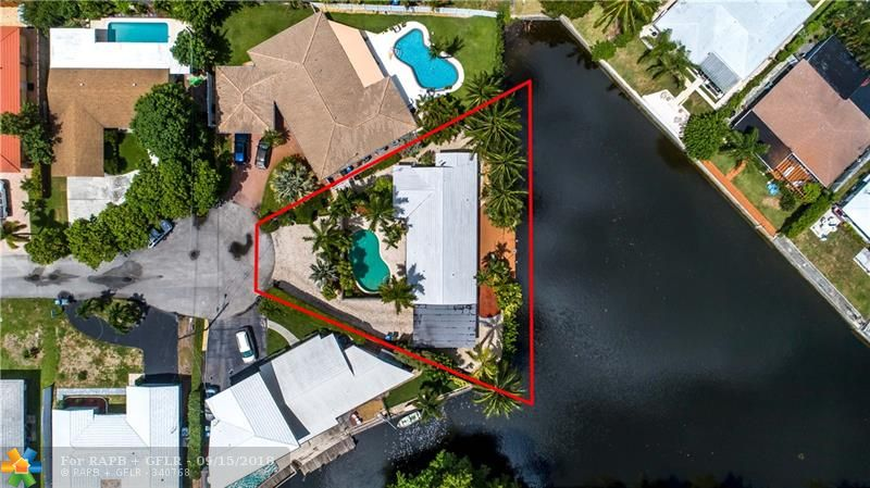 Hidden water front gem at end of cul-de-sac. Total privacy. Secluded pool & covered patio in front yard, wood deck with unobstructed canal views in back yard. Oversized sliding doors in all rooms. Bright & open living/dining/kitchen area. Open kitchen w/ granite counter, stainless steel appliances, bar and plenty of storage in ceiling-high cabinets. Large master bedroom w/ walk-in-closet. Huge master bath w/ double pocket doors to bedroom, separate lavatory, glass shower, double sink and tub. Split level 2nd bedroom. Second bath w/ walk in shower and separate exit to back yard. Two water heaters (one electric, one gas). 2 car garage has windows and could be easily converted into 3rd bedroom / in-law-suite. Travertine driveway. ADT alarm system. Completely fenced in.