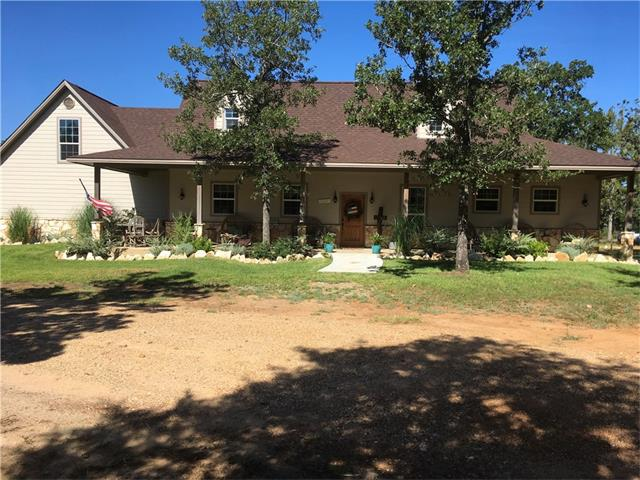 This is a must see property in the beautiful and rolling Twenty-two Hills subdivision near Gause. Property is situated on a hilltop. This two story, custom home features 2,928sf of heated living space, 3 bedrooms plus a bonus room (could be 4th bedroom) & 2 1/2 baths. The spacious country kitchen features lots of counter tops and storage space & opens into dining and living space which features a beautiful fireplace & wood-look, ceramic tile floors. Large windows allow for natural lighting.