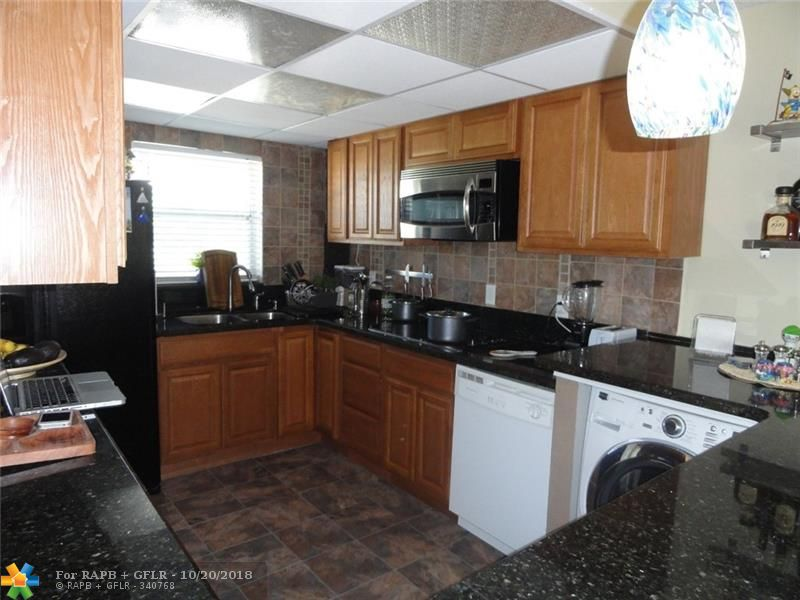 Wonderful condo in a great community. This 2 bedroom 2 bath condo features an updated kitchen with granite counter tops an updated bathrooms, pergo floors through out except the master bedroom. Bedrooms are big enough to accommodate a king sized bed in each room. Centrally located complex features a gated entrance, plenty of parking, tennis courts, racquet ball court, billiards room, sauna, gym and a delightful pool.This complex is user friendly and accepts pets up to 25 pounds.