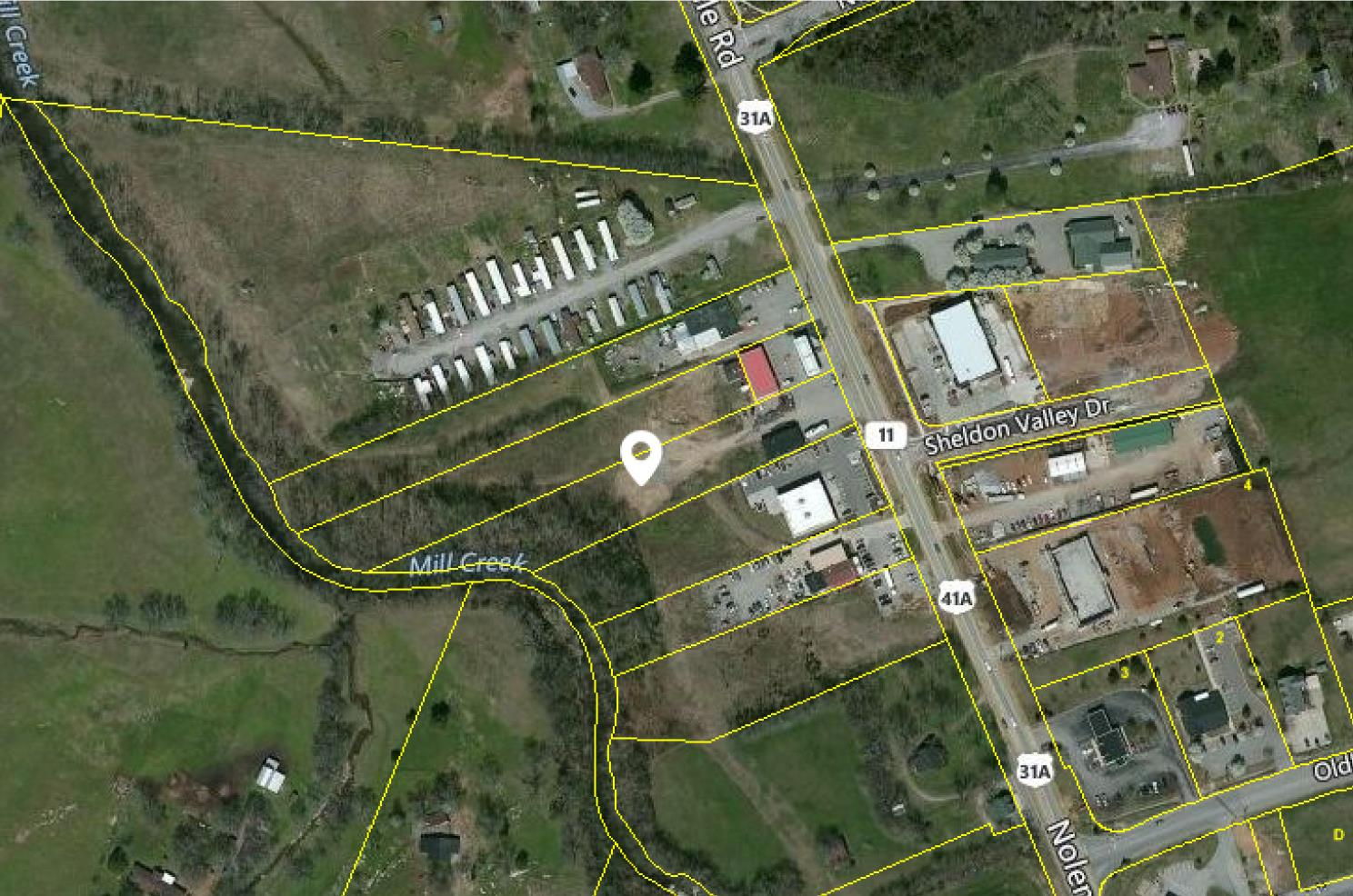 Outstanding Development Opportunity in Nolensville! Sale includes 7207-7209 Nolensville Road. Prime location in Nolensville consisting of 4.04 acres of property including a convenience market, warehouse building, and apartment. Convenience market totaling 3200 sqft.  Warehouse building totaling 2183 sqft.  Apartment totaling 896 sqft.