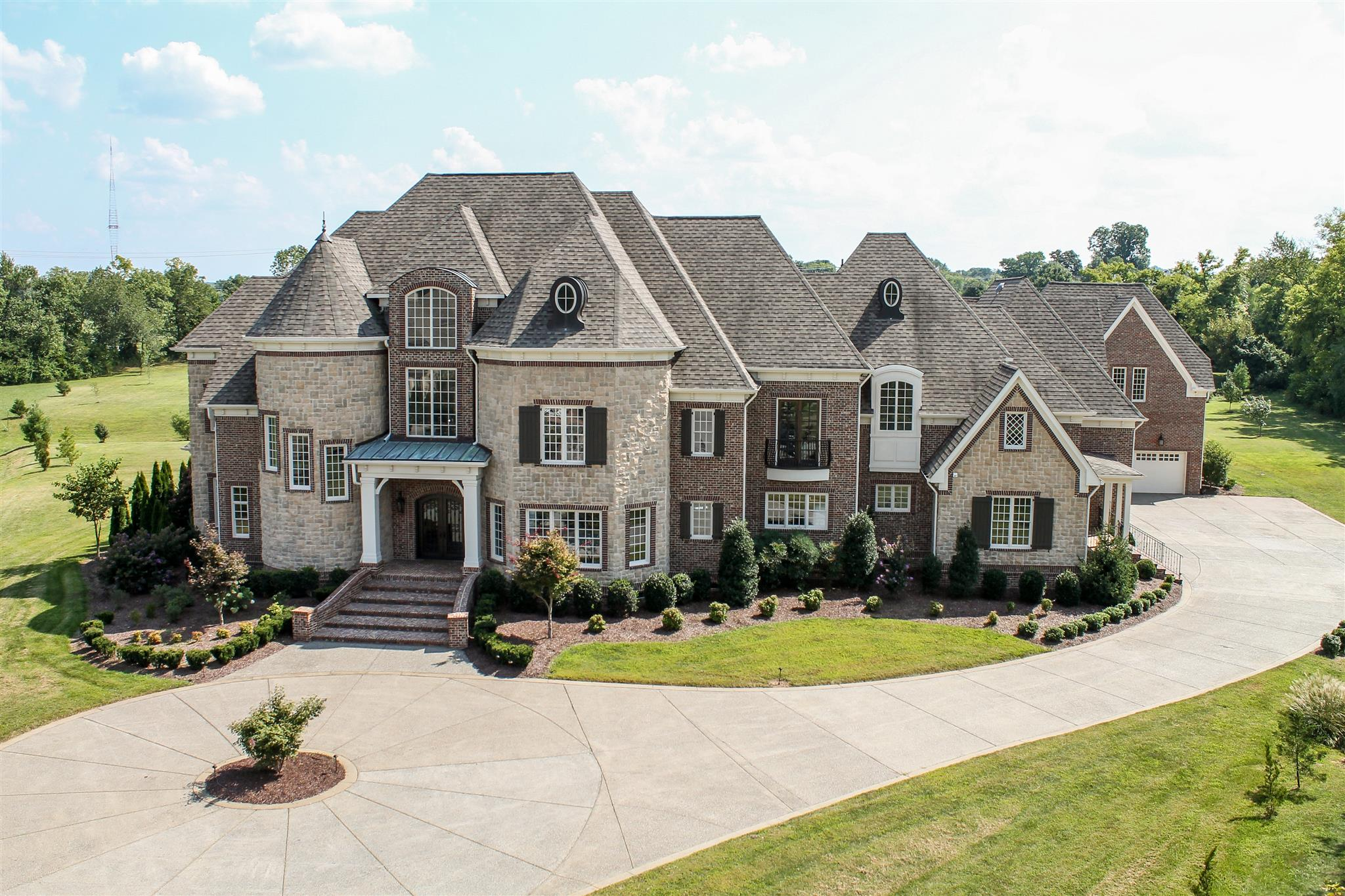 This ultimate estate for entertaining sits on 3+ acres in Brentwood. This 3-story luxury home is 14,680 sq. ft. with 6-car climate controlled garage, in-law quarters with a separate entrance, and an elevator that services garage & all levels of the home.