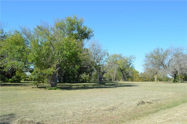 This ranch would work well for development or a horse property. Currently has ag exemption and several tenants that are o  month to month leases. The value is in the land not in the buildings. There are a couple of ponds that would work well for park area. Please do disturb the tenants. Must have appointment to show !!