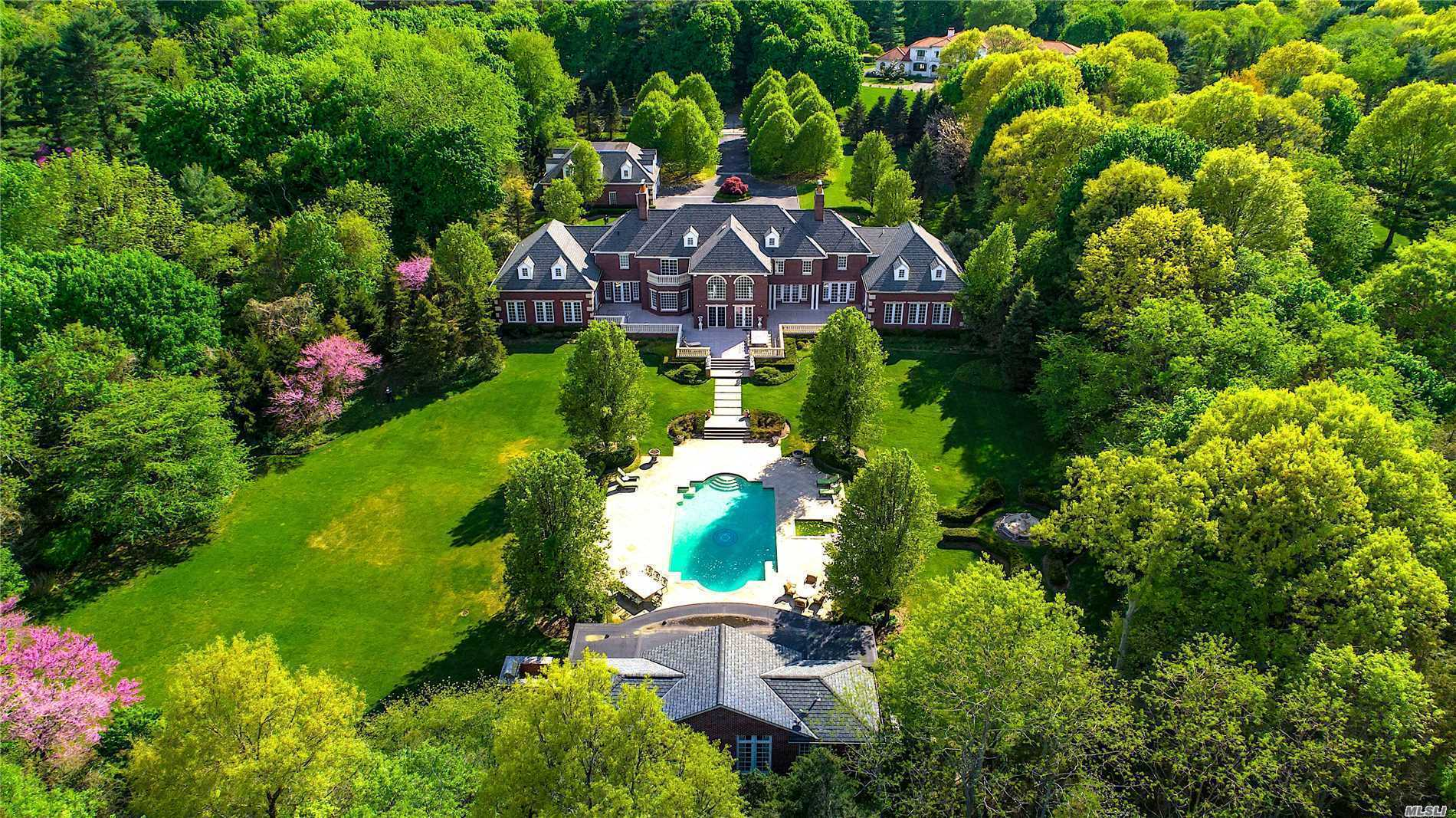 Unparalleled Privacy Abounds In This 8,800 Sq. Ft Classical Brick Home In The Prestigious Village Of Upper Brookville. Traditional Floor Plan Delivers 7 Bedrooms, 7.5 Baths, Double Bridal Staircase, 5 Fireplaces, Ig Gunite Pool With A Cabana. 9 Car Radiant Heated Garage. Ideally Set On Over 5 Acres Of  Beautiful Landscaped Property With Specimen Plantings And Trees. Reminiscent Of Formal English Gardens With Cobbled Courtyard And Gated Entrance.