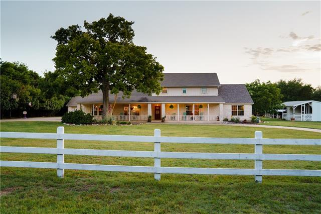 Picturesque farmhouse - interior renovated - kitchen, master suite, office, game room, all bathrooms! Recessed lights, crown molding, concrete floors, granite counters, built-in shelves/cabinets, outdoor patio, built-in fire pit & grill. Detached 2-car garage + 2 bed/1 bath casita, full kitchen & living space. 2-stall horse barn converted to temp-controlled foam-insulated storage. Unprecedented charm w/many mature oaks on peaceful 2+ acres. Fully fenced & animal-friendly - horses, chickens, goats, dogs.