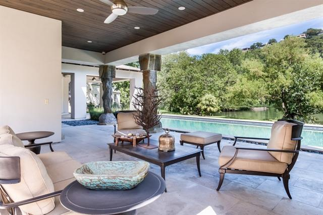On the coveted shores of Lake Austin, this quintessential custom estate features 1.5+ acres of flat land, gated privacy & lush landscaping with shady trees. A 2-slip boathouse and +/- 537 feet of prime waterfront. Warm interior finishes enhance and capture the picturesque views from the floor to ceiling windows, outdoor terraces, & balconies.  Office & casita each w/separate entrances, movie theatre,  nanny/au pair bedroom. A rare find for the discerning who want to live the ultimate Austin lifestyle!
