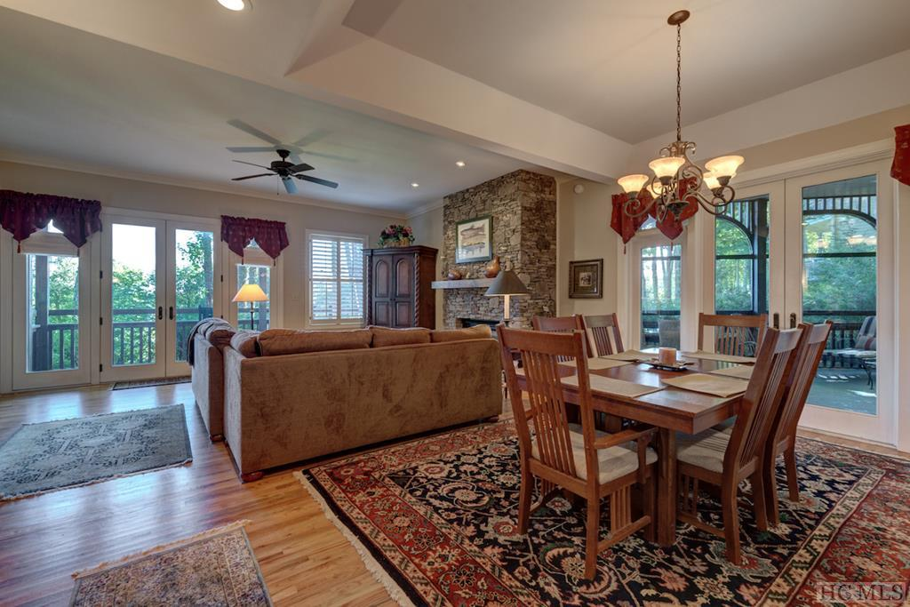 One level living with a beautiful golf course view and only a few steps going in! This 3 bedroom, 3 bath condominium is located half way between the two charming towns of Highlands & Cashiers in the gated community of Old Edwards Club. Open floor plan with beautiful hardwood floors, 10 ft. ceilings throughout, crown molding, exceptional outdoor living space with a screened porch off of the dining room and another porch off of the living room.  The living room has a floor to ceiling stacked stone gas fireplace and the kitchen has all new stainless appliances. The master has a great view of the golf course with access to the porch, tiled shower, jetted tub and walk in closet. The owner is in the process of updating the two guest baths to frameless tiled showers, adding granite or stone countertops to all baths & replacing the carpet in the guest bedrooms. Comes fully furnished!