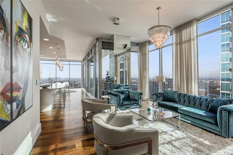 This exquisite 3 BR/3BA one-of-a-kind luxury residence on the 34th floor of the Loews Atlanta Hotel offers 270° panoramic views of the Atlanta skyline, Buckhead, Piedmont Park, and Stone Mountain through 12' floor-to-ceiling glass walls. Spacious interiors boast timeless, elegant, and bespoke features throughout. Additionally, the resort style amenities include an owners' heated rooftop pool/event terrace, owners' clubroom/media lounge and access to all hotel amenities.