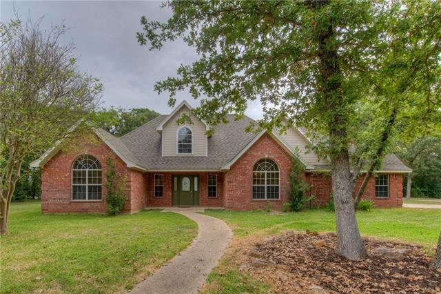 Charming Country Home! Located on just under 11 acres of land with plenty of mature trees and awesome views from the covered back patio. This beautiful home has 4 bedrooms, 3 1/2 bathrooms and a flex space upstairs. Master down. Four sides brick. The property is currently Ag Exempt and has a water well and septic on-site.  Interior features include beautiful laminate floors, vaulted ceilings and an island kitchen. The perfect blend of country feel & convenience of being minutes from downtown Rockdale!