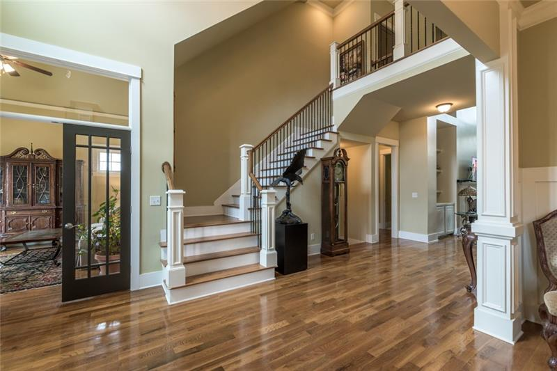 Two story foyer view with office/study/formal living to the left and dining room to the right of this picture.