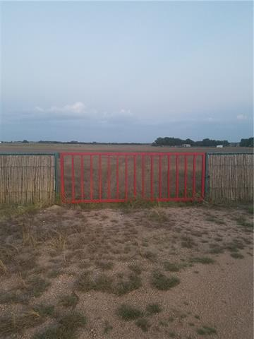 Live in a country setting but close to the city! 21.8 acres to build home or for small farm or horse/cow property in Weir just minutes from East View High School. Minimal restrictions, but no HOA. Stock tank/pond is about 15 +/- feet when full. (No fish in tank at present.) Jiggs bermudagrass was planted and harvested for hay over past several years.
