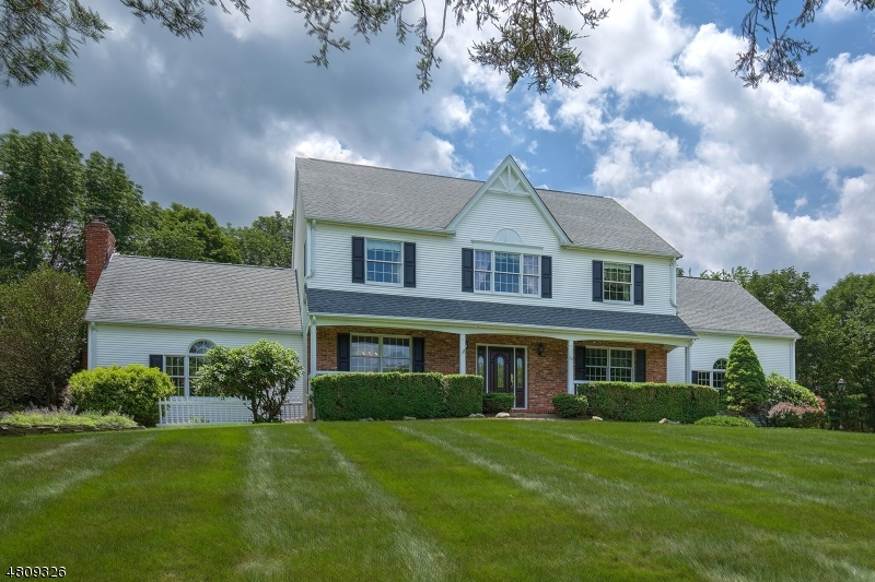 EXTENSIVELY UPGRADED BRICK-ACCENTED COLONIAL ON 3± CUL DE SAC ACRES   A fine selection of updates enhances an exceptional brick -accented Colonial in Readington Township. Nearly $300,000 in upgrades were added to the 3,700+ square foot open floor plan from 2003 to 2018. Custom-built and designed for a luxury lifestyle, it is sited on 3± acres of open landscapes amid natural scenery. The pastoral location on a cul de sac is in an established neighborhood near commuting routes. Entertainment-friendly features include a covered front porch, spacious rear deck, a bright sun room addition and brick paver patio for outdoor get-togethers. A built-in generator lends additional peace of mind.  The stunning layout of four bedrooms and two-and-one-half baths offers two fireplaces, intricate trim, hardwood flooring, high ceilings, circle top windows and recessed lights. Approached by a paved drive edged in Belgian block, the traditional Colonial architecture creates a welcoming presence on the acreage. An attached two-car garage and mostly-finished basement are further amenities.  Introducing the home is an elegant entrance foyer flanked by formal living and dining rooms detailed with moldings, both perfect for special occasions. A bright, airy sunroom addition is anchored by a gas fireplace and is heated and air conditioned for year 'round comfort. It opens to the rear deck and patio for outdoor fun.  The chef's center island kitchen features upper-end stainless steel appliances from Viking and white cabinetry and granite countertops; it adjoins a sun-filled breakfast area overlooking the backyard which connects to the expansive rear deck. Flowing from the kitchen is a dramatic two-story family room, where a brick wall wood-burning fireplace soaring to the top of beamed ceilings creates a commanding focal point.  Completing the first level is a powder room, laundry and access to the attached two-car garage.  Upstairs, a spacious master bedroom features a sitting room, large walk-in closet with California Closets organizers,  and a sumptuous master bath. Three additional bedrooms share another full bath on this level.  The 800 square foot finished basement provides a spacious gathering area for entertaining and casual get-togethers. Design elements in this expansive level include Berber carpeting, wall-to-wall raised paneling, multiple storage closets, recessed lights and a sound system. It is currently arranged as a recreation room, home office and game room.  This captivating Colonial provides abundant curb appeal and a central location about halfway between Clinton and Flemington, putting it near major highways, shopping, dining, parks and public transportation. Situated in Hunterdon County, Readington Township encompasses a number of small villages and hamlets, with many buildings listed on the National Register of Historic Places.  Antique buildings, charming shops and quaint inns dot the area, which offers scenic beauty to visitors and natives alike. Close proximity to Routes 78, 22, 31 and 202 offers access to many of the state's business campuses and corporate centers. Outdoor activities can be enjoyed locally at Round Valley Recreation Area.