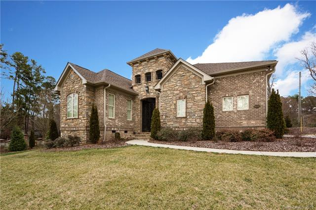 Incredible custom built ranch.  This exquisite property is truly one of a kind full brick and stone accented ranch.  Enter the wrought iron gate to your courtyard area and then to your open floor plan that offers hardwood flooring throughout all main living areas and bedrooms with ceramic tile adorning the laundry and bathrooms. The gourmet kitchen will impress any chef with SubZero refrigerator, gas cooktop, double ovens and built in microwave.  The custom cabinets and two tiered granite countertop is designed for cooking and entertaining.  The split floor plan is designed for living and privacy with substantial closet space.  Access the laundry room off the hallway or directly from the master bathroom. The third bedroom is accessible from the courtyard area and offers an office/sitting area.  Each bedroom has an en suite bath.  This is built to the highest standards.