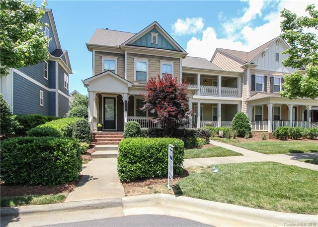 $2500 BUYER CREDIT!! Enjoy NO maintenance living in this End Unit Townhome located in the HIGHLY desirable MCCullough! BEST LOCATION IN THE CHARLOTTE AREA! You will be impressed w/ the Craftmanship of this John Wieland Home;10 Ft Ceilings, 8 FT Doors, Wide Plank Hand Scraped Hardwood fls on the main, spacious open floor plan & fireplace with Built-in's. The Kitchen has high-end cabinetry, a breakfast bar, granite counter tops, tile backsplash & SS Appliances. Enjoy 2 dining option off the Kitchen. You will find 3 bedrooms on the 2nd floor, including the Master Bedroom. The Master features built-in's, walk-in closet, on-suite bath with upgraded tile floors, shower & garden tub. The hall bath is attached to 1 of the 2 bedrooms. The 3rd floor is a MOVIE/BONUS room with projector, screen & surround sound. Private fenced backyard with patio and 2 Car Garage! McCullough Offers High End Amenities-Olympic size pool, Club House, Tennis Courts, Playground, Dog Park, Pond, Walking Trails & Parks.