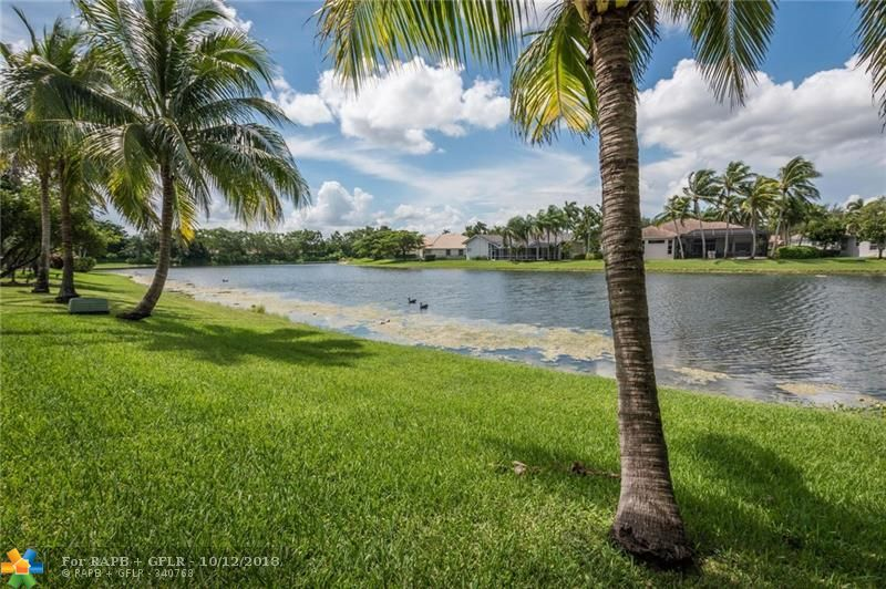 JUST REDUCED!!! METICULOUS AND IMPECCABLE HOME IN THE BEST KEPT SECRET COMMUNITY IN TOWN. THE ISLANDS LOCATED RIGHT IN THE MIDDLE OF THE CITY OF WESTON. WALKING DISTANCE TO THE TOWN CENTER AND ITS RESTAURANTS. THIS BEAUTIFUL HOME IS LOCATED ON A LAKE FRONT AND FENCED LOT WITH A BUILT IN PAVED PORCH WITH A BEAUTIFUL PERGOLA. IT OFFER THE PEACE OF MIND OF A NEWER ROOF, NEWER A/C, ACCORDION SHUTTERS, ONE FULL BEDROOM WITH BATHROOM DOWNSTAIRS, WOOD FLOORS, GUTTERS AMONG OTHER FEATURES. CALL FOR YOUR PRIVATE SHOWING.