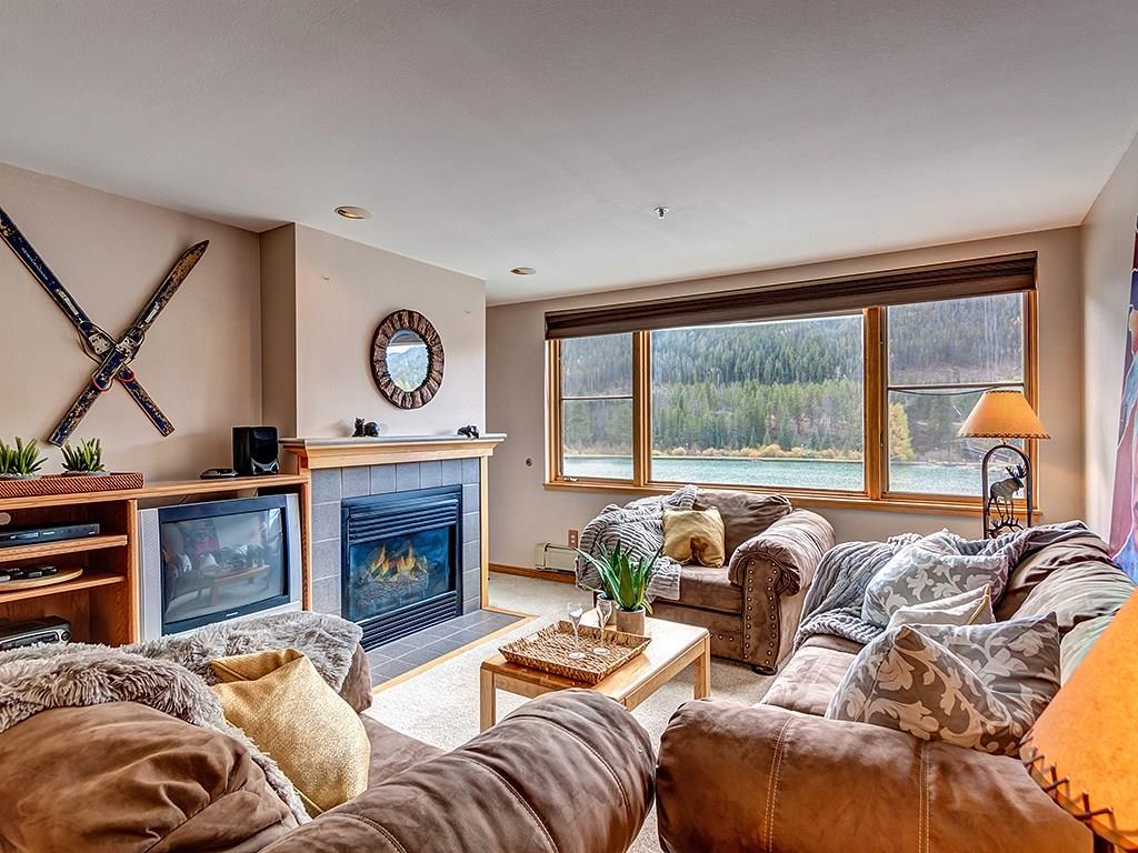 "THIS CONDO COMES WITH A DEEDED GARAGE.   Amazing location on Keystone Lake , this large 1 bed Lakeshore ""End-Unit"" has wonderful views of the Lake and  the Snake River Valley.  The 4-star Keystone Lodge with great restaurants is a short walk. Near the Adventure Center -rent a canoe or play hockey in the winter.   Don't miss this chance to own a spacious 1 bed room located on Keystone Lake.   All of the utilities are included in the monthly HOA fee.   Use of the East Lake Rec building and Pool."
