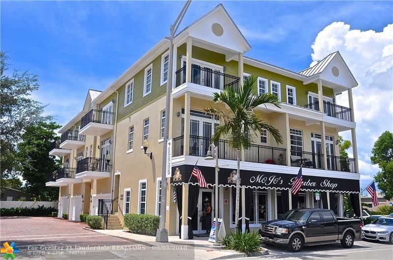 This elegant townhome in central Wilton Manors is steps to restaurants, bars, Publix and more.  With a walk score of 82, leave your car in the garage and enjoy being in the middle of everything.  This 2,440 square foot, 3-bed, 3.5-bath, dog friendly home features a large 1st floor guest room with private 12' x 24' garden.  The 2nd level is a spacious open kitchen/living/dining room with 12' ceilings, stainless appliances, granite countertops, and a private balcony.  The 3rd floor features a luxurious master bedroom with en-suite bathroom, walk-in closet, another balcony, and a large 3rd bedroom with its own en-suite bathroom.  Built in 2008, this home has impact doors and windows, full-sized washer & dryer, stone flooring, a 2-car garage, and more storage than you'll know what to do with.