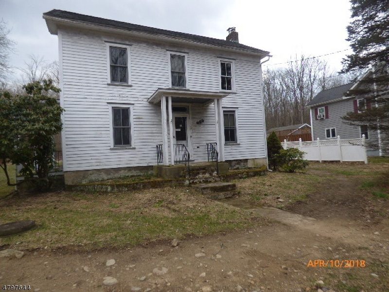 Colonial farmhouse style with 3 bedrooms and 1 bath, several outbuildings that can be used for storage. Sold As Is all inspections and CO are the responsibility of the buyer.  Close to all amenities and commuting arteries. There is a creek alongside of the property, Flood insurance may be required.