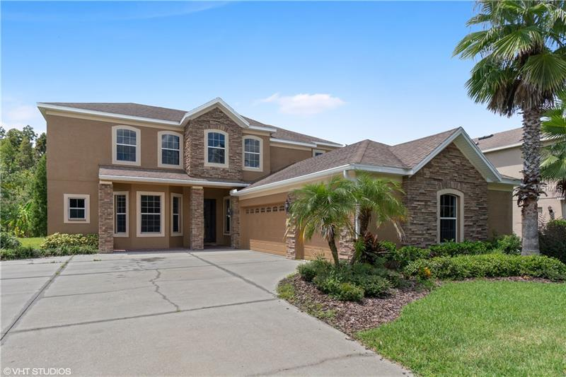 New Listing: In the Basset Creek Estates Community of New Tampa. A quiet nature like community nicely tucked away yet near to all! The grass is green & the flowers are blooming! Come and see all the benefits of this 10 year old home that is recessed nicely from the street with tons of driveway space. Perfect for young ones to play and have a ball. The floor plan is traditionally perfect for entertaining with a formal LR & DR. The Family room has a modern open concept that shares views to the backyard lanai, conservation, breakfast nook & kitchen area which is filled with granite counter tops, stainless steel appliances, caramel cabinets & a complimentary back splash. You will appreciate features of ceiling lights, engineered wood flooring & so much more. The Master suite is conveniently located on the 1st floor which boasts of a garden tub, seperate shower & dual sinks. The perfect place to unwind after a long day at work or out jogging in the community. All secondary bedrooms are nicely sized & located upstairs. But not w/o taking notice of the large bonus room & a smaller loft area that leads to a very quiet flex space which is perfect for a home office, man cave, or crafts room. The home has so much to offer not to mention your choice of new paint colors before closing. We Have Top Rated Schools & Near to USF, VA Hospital, Wiregrass Mall, Premium Outlets & All The Restaurants Your Heart Desires! Come & see why this home is perfect for your family before it is gone! Call Today for your private tour.