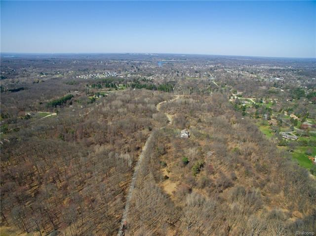 30 Acres+-  tax #s-16-12-126-031.  Prime development or home acreage in Milford Twp. Rolling,wooded and just east of the Village of Milford!Good soil conditions. Paved private rd and 5 existing homes on separate lots in Village View Estates.  1.5 acre minimum lot size.Some survey work available. Great location in Milford Twp. and close to schools,parks and Downtown Milford.
