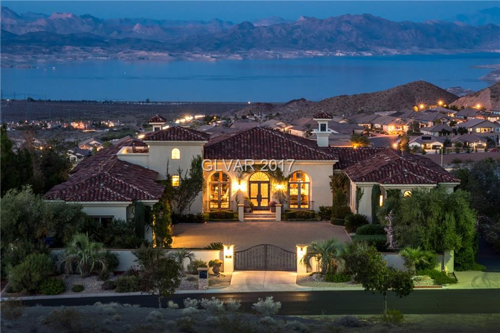 Custom Mediterranean Estate w pano views of Lake Mead & Mtns. Nearly 8000 sq ft of perfection with 3 story self-suspended handmade spiral staircase, Custom Travertine floors, Hand honed 8 foot Alder doors throughout, all custom iron work. Minutes to historic downtown. Private theater with 7.1 Surround sound, Veranda, Control 4 Home Automation, 2x6 commercial-grade construction, Granite and Marble surfaces, spool with 3 fire features, 4+garages