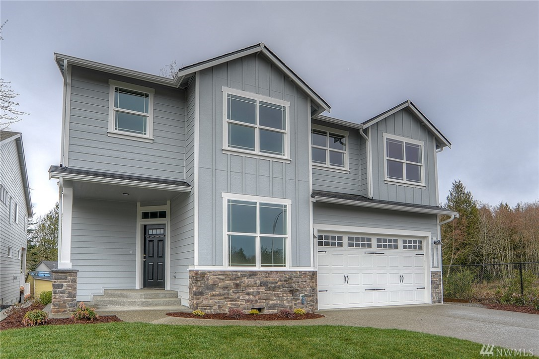 New home in Deschutes Heights by Gruhn Homes features 2953 sq ft, 4 BR + bonus room, 2.5 BA, laundry up, den down, dining room, and open kitchen/great room. Quality features include quartz counters in kitchen, 1/2 bath, & master, designer lighting, extensive hardwood flooring, tankless H2O, wainscoting, crown molding,and fully landscaped w/fenced back yard. Excellent Tumwater location in community of new homes.