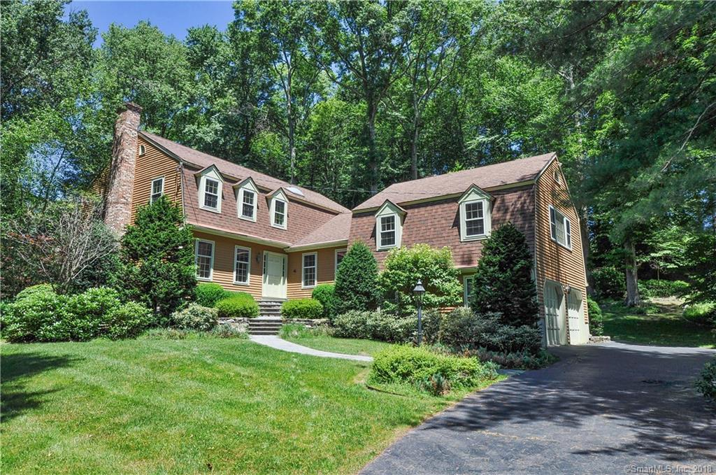 Nestled on a private cul-de-sac in Greenfield Hill, this wonderful 4-5  Bedroom, 2.5 Bath Colonial sits on 2+ acres of beautiful property with established mature landscaping.  All rooms freshly painted, with newly exposed hardwood floors throughout!  With 3600 square feet of space this charming home offers a well thought-out floorplan with large sun-kissed rooms, high ceilings, rich hardwood floors and multiple living spaces to accommodate any family. The gracious living room boasts a sophisticated fireplace, and opens up seamlessly into the formal dining room and then into a spacious, eat-in kitchen. The family room features vaulted ceilings, beams and a fireplace. A sunny library and spacious game room with fireplace offers fabulous options for a future in-law suite. The superior craftsmanship and quality continues on the upper level with a lovely master bedroom suite with full bath, dressing room and walk in closet. Three additional, spacious bedrooms and full hallway bath complete this floor.  Enjoy the peace and tranquility of this lush property, whether it be a family dinner on the private deck or playing with kids in the wooded hills or level yard.  2 car attached garage. Do not miss this amazing opportunity in an incredible Greenfield Hill neighborhood!!