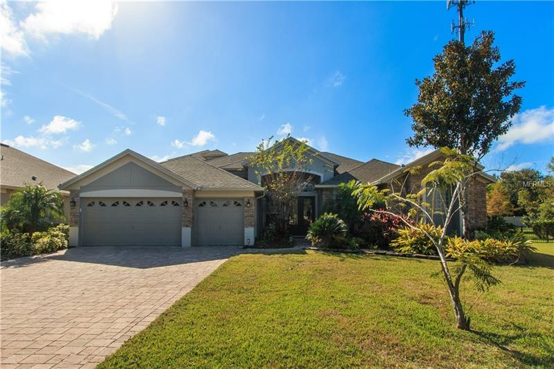 """Exceptionally remodeled, upgraded, modern & completely custom! Over $400K in upgrades! 5 bed, 4 bath plus office, bonus & resort style pool! Completely reconfigured gourmet kitchen with Siematic cabinets, 9 ft island & Miele built-in appliances- oven, steamer/convection oven, fridge, dishwasher, wine fridge & induction cooktop. Master bed/bath features two walk-in closets with built-ins, 72"""" freestanding tub, walk-in shower, double vanity, extra storage, wall-mounted fireplace/steamer and back-lit ceiling. All bathrooms remodeled to include Japanese Toto toilets. Family room has built-in shelving & remote controlled gas fireplace. Stunning wall of built-in shelving with accent lighting in formal living room. Upgraded AC, hybrid water heater & whole house water filtration system in 2015. Lower level is all tile & wood laminate. Custom lighting throughout. Bonus with bedroom & bath upstairs. Pool/patio area feels like a resort- massive gas heated salt pool with spa & waterfall, outdoor kitchen, screened lanai, square pavers & additional unscreened patio. Beautiful clumping bamboo border along back property line. Custom fenced back yard for total privacy. Award winning Lake Forest has 24-hr guarded/gated entry & resort-style amenities: 10,000 sq ft clubhouse, fitness room, Jr. Olympic-sized swimming pool, heated spa, playground, 55-acre private spring-fed lake, fishing pier, & 6 lighted tennis courts. Lake Forest is close to I-4 & 417. This home is the epitome of luxury and an absolute must-see!"""