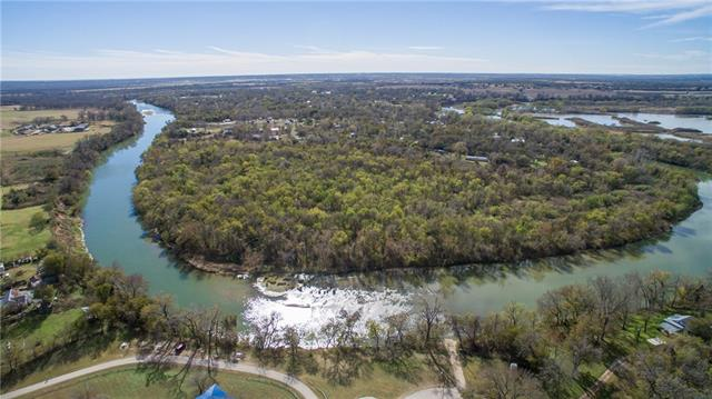 Rare opportunity to own 28 +/- acres on the Colorado River!  Sale includes 1300-1303-1305-1307 Man O War , four contiguous lots in the River Timber neighborhood. There are utilities and well on the property as well as city water.  The property is just 15 minutes to the airport and the Circuit of the Americas race track.  This is an up and coming area with tons of potential.