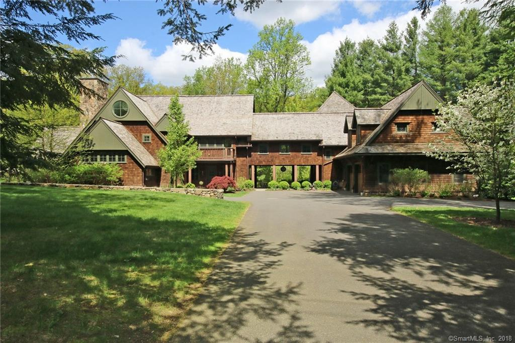 """My favorite house in Redding"". Glorious family compound in sought-after location. Privacy and space for everyone. Custom built shingle style Adirondack home with sophisticated & open modern floor plan on picturesque 3.2 acres w/stone walls, stone walkways, professional landscaping, plus private pond & waterfall adjoining New Pond Farm's 102 bucolic acres. Inspired by the property's majestic natural beauty, this exceptional private retreat was designed for year round indoor/outdoor entertaining with multiple stone patios; 3 season timbered porch with stone floor & 8' wide Rumford fireplace; plus attached cottage with separate entry featuring the ""summer kitchen"", ideal for home office, studio, or guest quarters. Walk-out lower level billiards room and gym; 5 bedrooms; 5/2 baths; 5 fireplaces; bonus room; plus 3rd floor art or yoga studio. Exquisite attention to detail with 18' ceilings; exposed beams; open stairways; walls of windows & soul stirring views. The main level features the spectacular gallery entry foyer; soaring great room including kitchen/breakfast nook, dining room and living room open to the adjoining family room. Enjoy the best of both worlds with tranquil setting yet top West Redding location for commuting, shops, restaurants, less than 10 minutes to downtown Ridgefield, and walking distance to New Pond Farm for the freshest local eggs, milk, and yogurt. Don't miss the link to the virtual tour and floor plans."