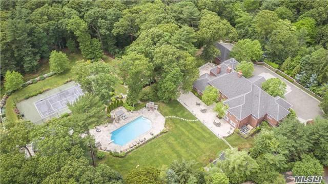 """""""Mirabelle Manor"""" -A Rare Opportunity To Own This Distinguished Brick Colonial  In The Prestigous Village Of Matinecock. Located 34 Miles To Manhattan.Extraordinary Details Throughout This 10,000 Sq. Ft. Residence ,6 Ensuite Bedrooms,Finished Attic With Playroom+Gym,Ig Heated Pool With Cabana,Har-Tru Tennis Court,Putting Green And Koi Pond Sequestered On 5 Private Acres."""