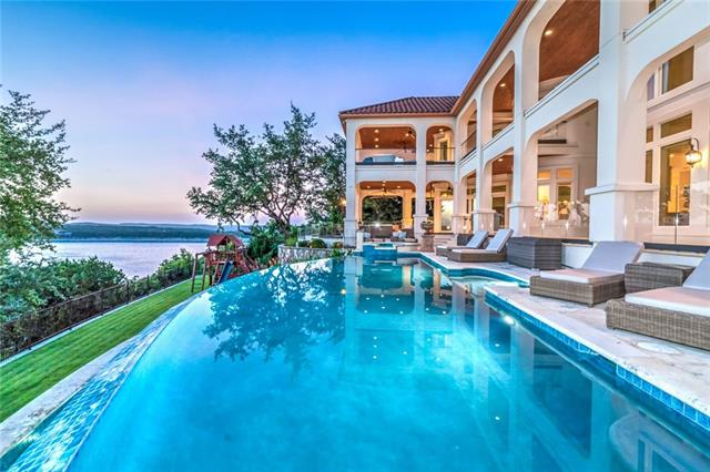 This magnificent waterfront estate sits on an extraordinary 2.8 acres overlooking the broad beauty of Lake Travis. The abundance of natural light combined with the white modern interior rooms creates a peaceful and inviting environment for friends and family. Terrace provides panoramic sunset views across the negative-edged pool and lawn. At the waters edge sits a private boat dock with lift and room for 2 jet skis. Extensive renovations to the interior and exterior of the house was completed in 2016.