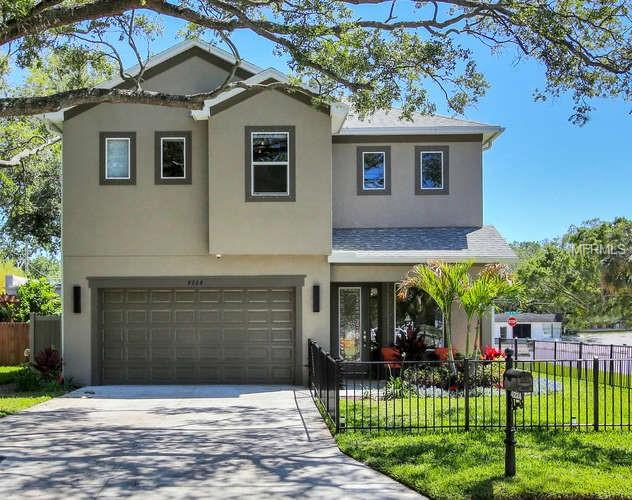 "Stunning contemporary custom built home set on a corner lot in the heart of south Tampa.  Home was custom built & completed in spring 2017 set in one of South Tampa premiere neighborhoods and school district. This exquisite property features 4 bedrooms and 3.5 bathrooms with a two car garage.  As you pull up to the home you are taken back by the perfectly manicured front lawn enclosed by custom black metal fence.  The charming front porch greets you as you walk to the front door.  As you step into home you are swept away with the clean contemporary feel with the high ceilings, crisp white walls, grey porcelain tile plank flooring,and natural light illuminating the home. A formal sitting area with Chilhuly inspired chandelier is gate way towards the back to a large family room/great room with the gorgeous kitchen off to the left and the dining room off the kitchen. The kitchen features white custom cabinetry with custom pull out drawer system, stainless steel appliances, granite counter tops, glass tile back splash, and closet pantry.  The large curved Island stretches along the exterior of kitchen with room for bar stools on the side by the family room.  Off to the side of the kitchen is the dining room with a beautiful light fixture setting off the room. French doors & windows stretch along the entire back of the home.  French doors open to the covered patio with TV hook up and fan.  The back yard is truly a special place to enjoy with the covered porch, awnings stretching beyond the porch, turf backyard, and the focal point a water fall set in the back center framed by two succulent vertical gardens. The Upstairs features a large master suite with two walk in closets and custom closet systems. The on suite master bath features walk in shower, spa tub, dual sinks that include granite countertops, rich wood cabinetry, porcelain tile.   Just outside the master bedroom is a loft area great for watching tv or an office.  Two of the other bedrooms in the middle of the home share a ""Jack &Jill"" bathroom and the 4th bedroom has an on suite bathroom.  All rooms have walk in closets with custom closet systems.  The generous laundry room finishes of the upstairs.  This home has so many extra feature with no attention to details spared.  Meticulously designed throughout you don't want to miss this home!"