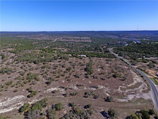 8.671-Acres of clean acreage cleared of all brush & cedar with only the oak trees remaining. Corner tract. 726 Ft of paved road frontage on county maintained Singleton Bend Rd & 389 Ft along gravel Post Oak Bend Loop. Fenced on three sides. Excellent views of miles of Texas scenic hill country. Electricity & phone lines along road. 1-mile to Gloster Bend Park on Lake Travis.
